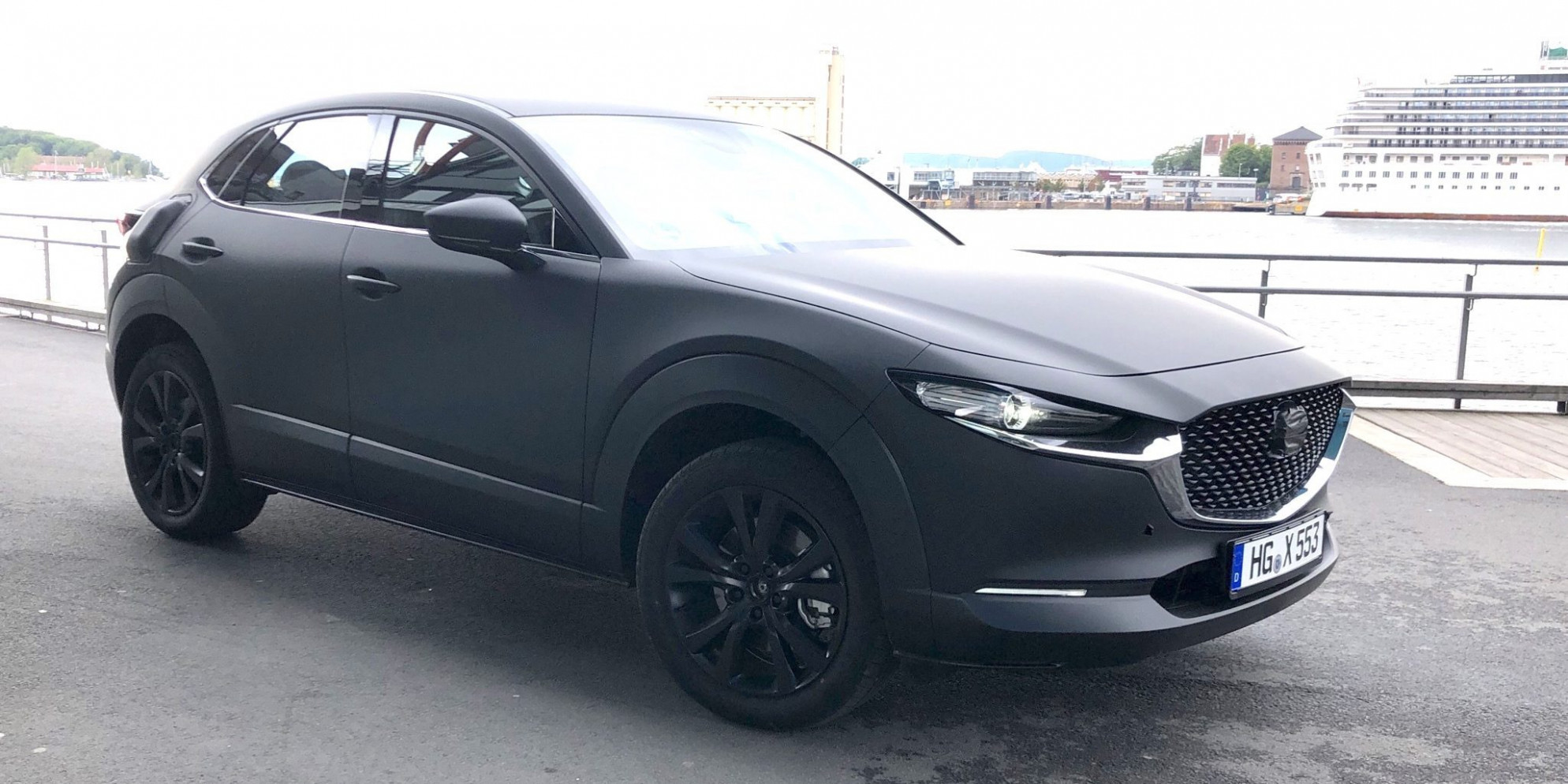 Mazda's first electric car spotted testing, looks like a CX-8 ...