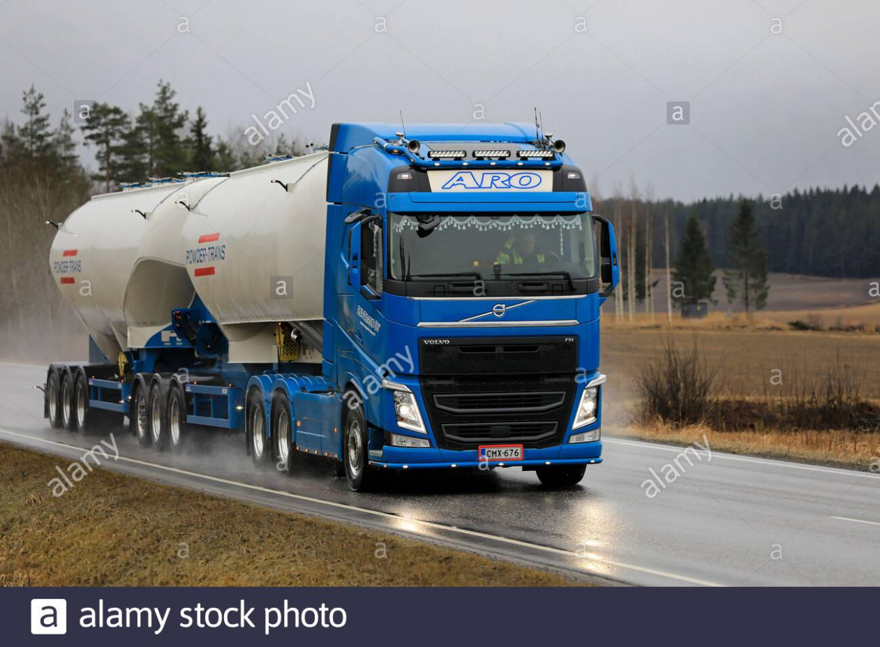 New blue Volvo FH 11 truck of Eja-Trans Oy pulls tank trailer ..