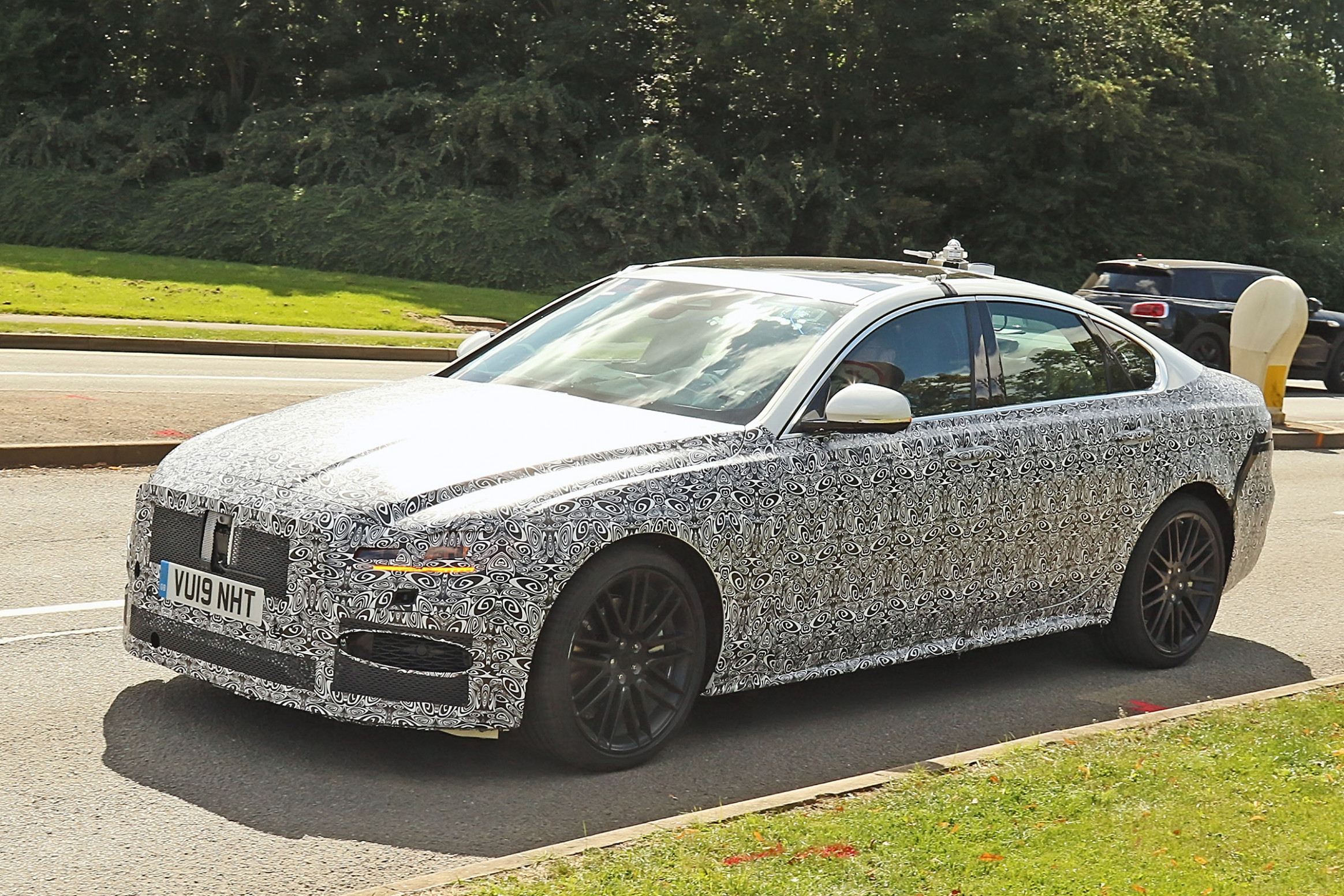 New Jaguar XF spotted ahead of 8 launch | Auto Express