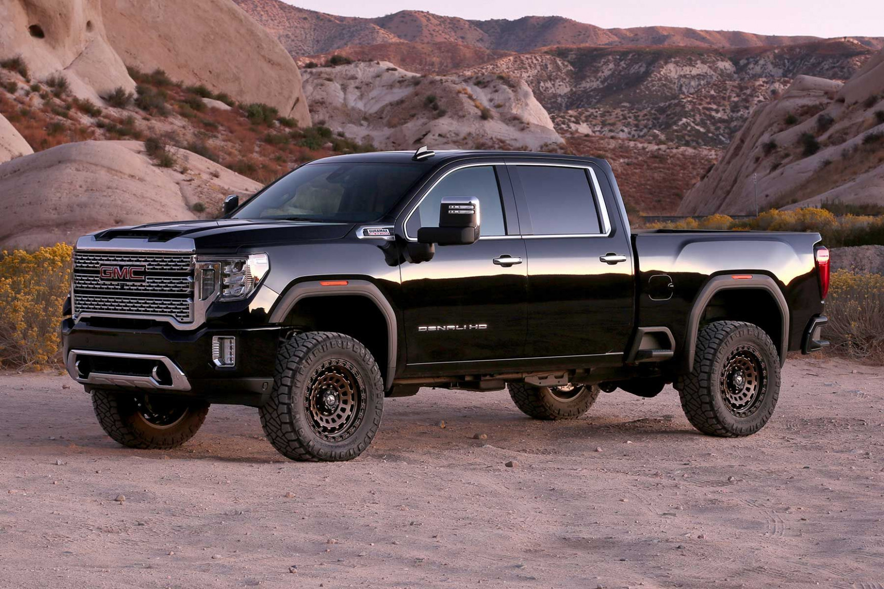 """8 GMC Denali HD equipped with a Fabtech 8.8"""" Lift Kit in 8 .."""